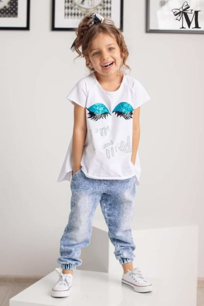 Długa bluzka dziewczęca o asymetrycznym kroju biała